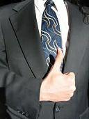 Business man giving thumbs up sign